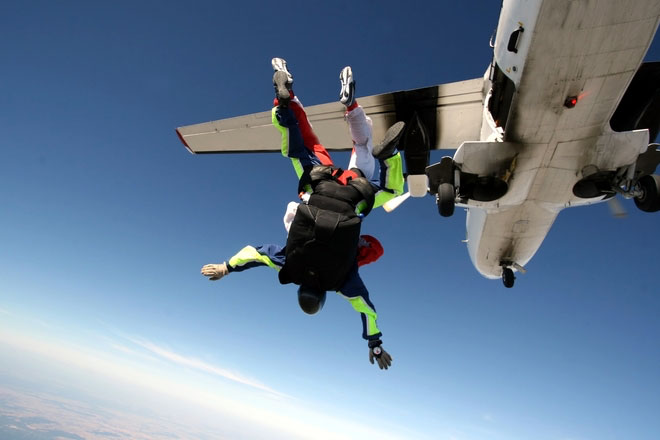 Skydiver jumping out of a plane